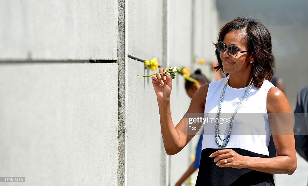 U.S. First Lady <a gi-track='captionPersonalityLinkClicked' href=/galleries/search?phrase=Michelle+Obama&family=editorial&specificpeople=2528864 ng-click='$event.stopPropagation()'>Michelle Obama</a> visits Berlin Wall memorial at Bernauer Strasse on June 19, 2013 in Berlin, Germany. Obama is visiting Berlin for the first time during his presidency and his speech at the Brandenburg Gate is to be the highlight. Obama will be speaking close to the 50th anniversary of the historic speech by then U.S. President John F. Kennedy in Berlin in 1963, during which he proclaimed the famous sentence: Ich bin ein Berliner.