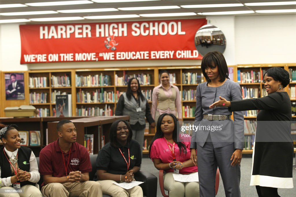 First lady <a gi-track='captionPersonalityLinkClicked' href=/galleries/search?phrase=Michelle+Obama&family=editorial&specificpeople=2528864 ng-click='$event.stopPropagation()'>Michelle Obama</a> (C) visits Harper High School in the Englewood neighborhood to talk with students about the plague of violence in their area April 10, 2013 in Chicago, Illinois. At right is principal Leonetta Sanders. According to published reports Chicago has had 79 murders in 2013. Twenty-seven of the victims have been under 21-years-old, the most recent victim was fourteen-year-old Michael Orozco who died April 7, from two gunshot wounds to his chest. A 17 and a 19-year-old are in custody for Orozco's murder.