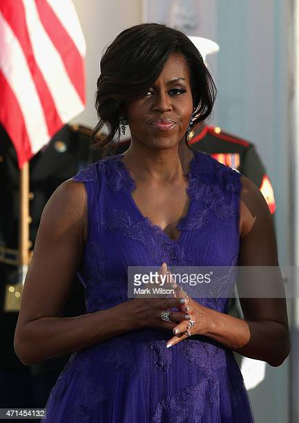 First lady Michelle Obama waits for the arrival of Japanese Prime Minister Shinzo Abe and his wife Akie Abe at the north portico of the White House...