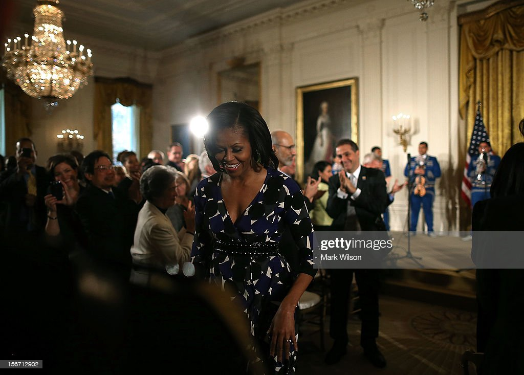 First lady <a gi-track='captionPersonalityLinkClicked' href=/galleries/search?phrase=Michelle+Obama&family=editorial&specificpeople=2528864 ng-click='$event.stopPropagation()'>Michelle Obama</a> walks away after an awards ceremony for the President's Committee on the Arts and the Humanities in the East Room at the White House on November 19, 2012 in Washington, DC. The first lady talked about the importance of afterschool and out of school arts and humanities education and presented awards recognizing programs across the country that benefit underserved youth.