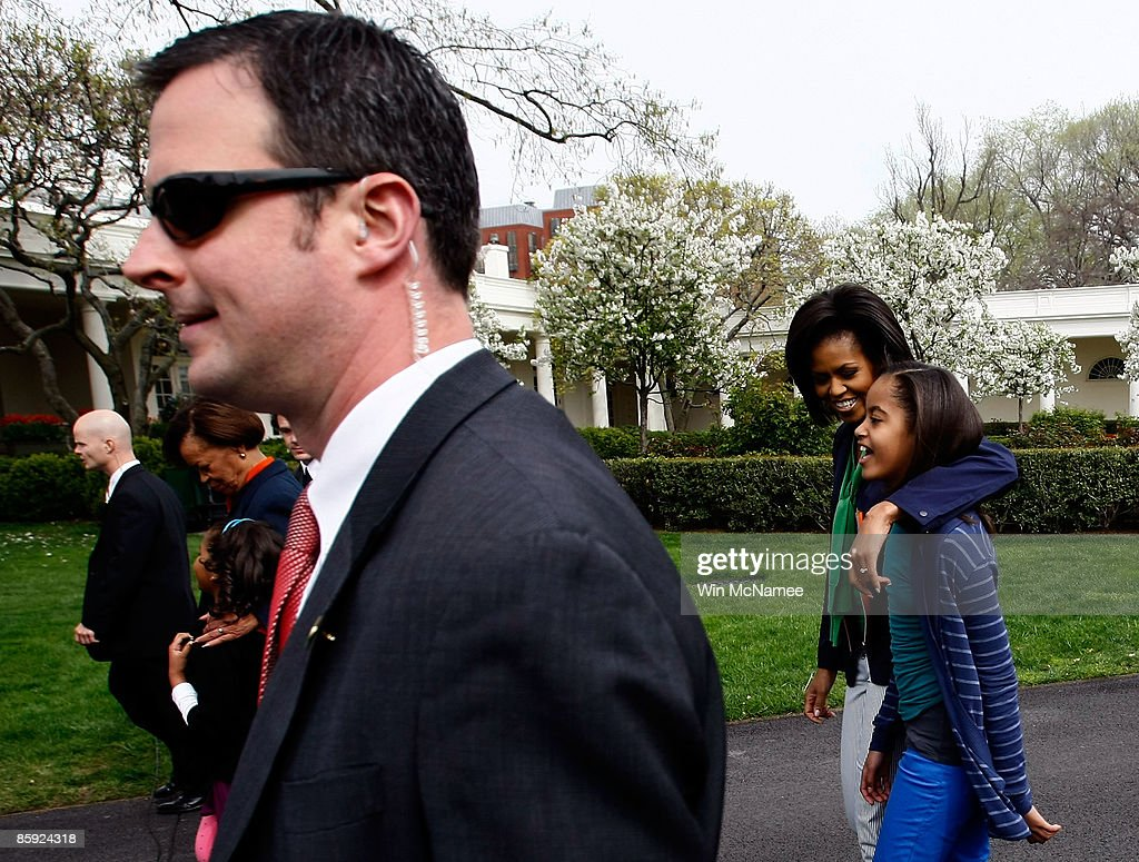 S first lady Michelle Obama walks with her daughter Malia Obama after the start of the White House Easter Egg Roll on the South Lawn of the White...