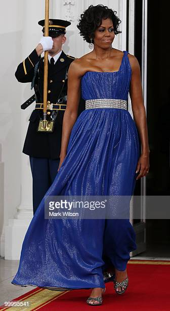 First lady Michelle Obama walks with her husband US President Barack Obama to greet Mexican President Felipe Calderon and his wife Margarita Zavala...