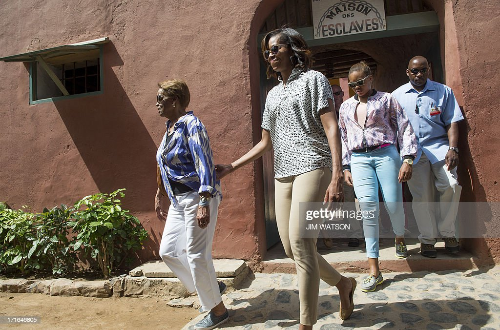 First Lady Michelle Obama (C) walks with her mother Marian Robinson (L) and her niece Leslie as they tour Goree Island off the coast of Dakar in Senegal on June 27, 2013. US President Barack Obama and his family toured the the House of Slaves at the site where African slaves were held before going through the door and being shipped off the continent as slaves.