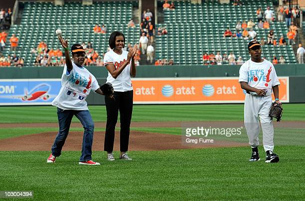 First lady Michelle Obama watches as Christina McCray of the Boys and Girls Club of America and Jordan Antwon Lewis from Reviving Baseball in Inner...