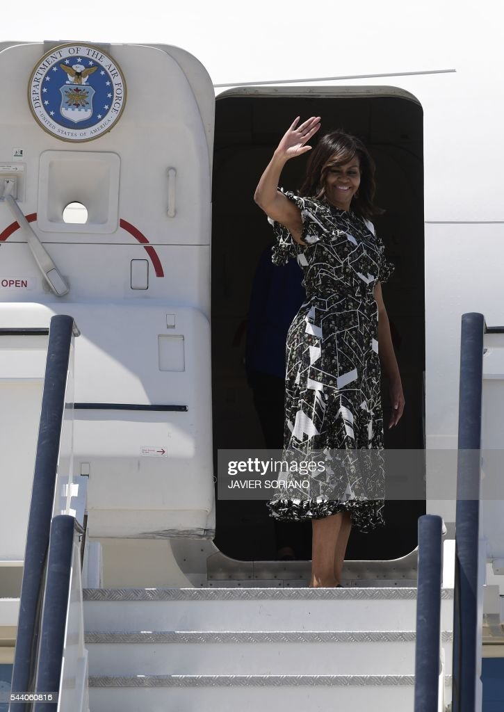 US first lady Michelle Obama waves as she boards an aircraft at the Torrejon air base near Madrid on June 29, 2016 a day after oresenting the 'Let Girls Learn' initiative . First Lady Michelle Obama began a two day visit to Spain by delivering a speech on the education initiative launched in March 2015 to help adolescent girls across the world access a quality education. / AFP / JAVIER