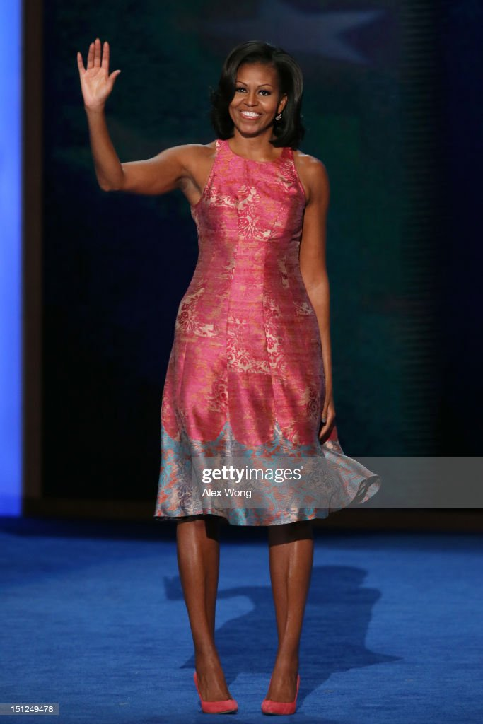 First lady <a gi-track='captionPersonalityLinkClicked' href=/galleries/search?phrase=Michelle+Obama&family=editorial&specificpeople=2528864 ng-click='$event.stopPropagation()'>Michelle Obama</a> waves as she takes the stage during day one of the Democratic National Convention at Time Warner Cable Arena on September 4, 2012 in Charlotte, North Carolina. The DNC that will run through September 7, will nominate U.S. President Barack Obama as the Democratic presidential candidate.