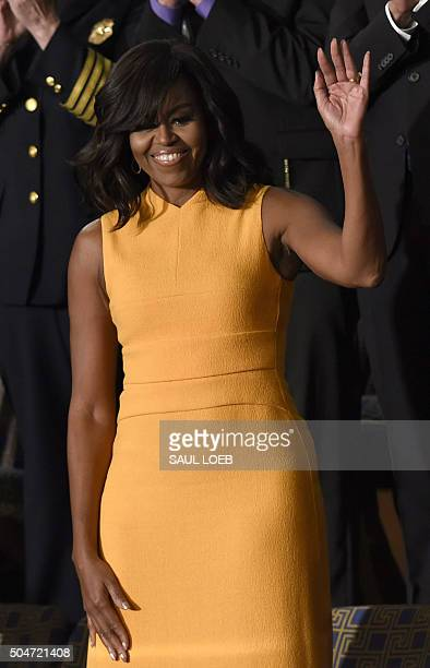 US First Lady Michelle Obama waves before the arrival of US President Barack Obama before the State of the Union Address during a Joint Session of...