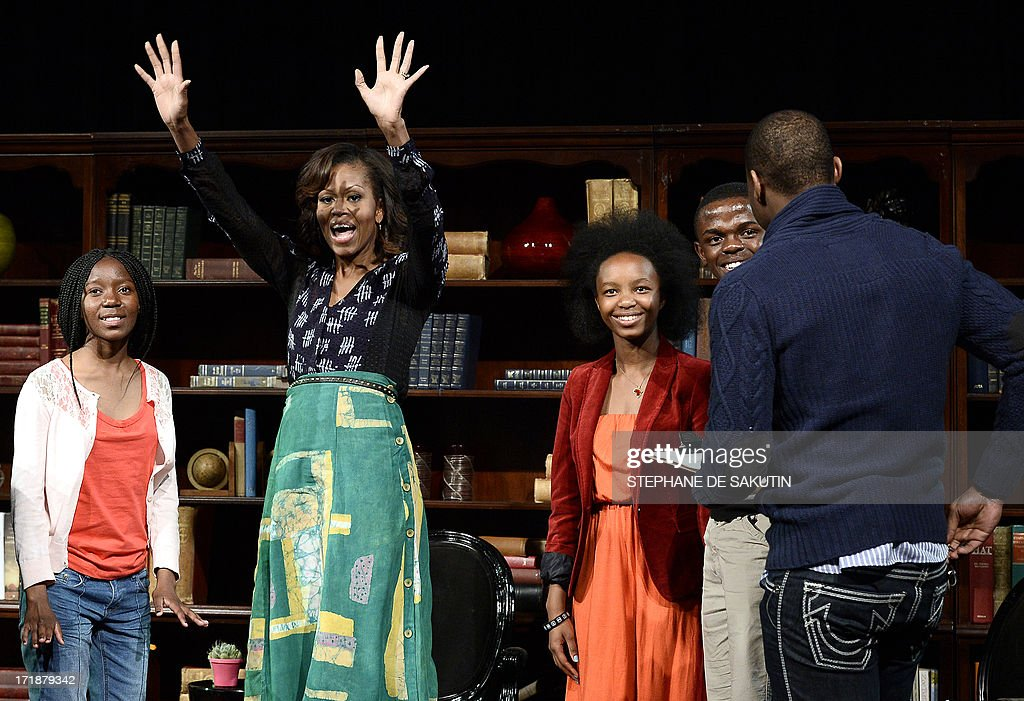 US First Lady Michelle Obama waves during a discussion with students on June 29, 2013 at the Sci-Bono Discovery Center in Johannesburg. The first lady was joined by teenagers from accross South Africa as well as students joining virtually from cities around the US. This virtual event has been organised in conjunction with African youth and music channel MTV Base and Google + to highlight the importance of education.