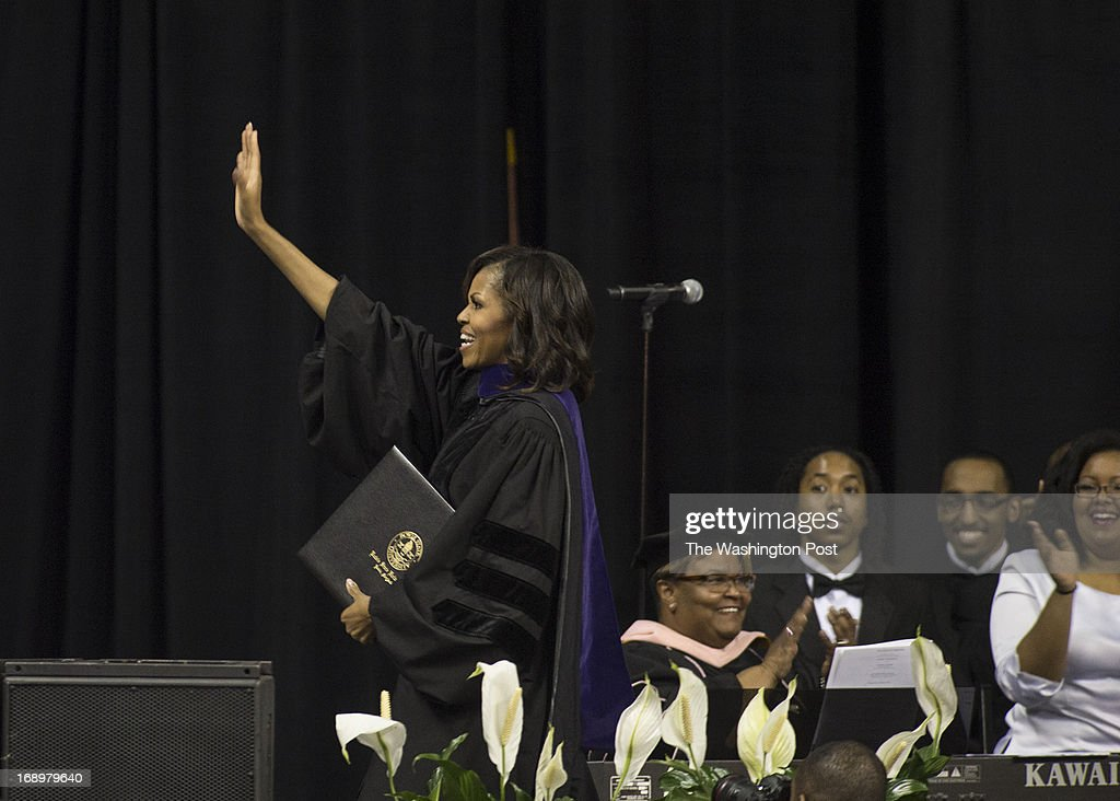 First Lady Michelle Obama waves goodbye after her 2013 Spring Commencement speech to students at Bowie State University held at the University of Maryland's Comcast Center in College Park, Maryland, on Friday, May 17, 2013. Mrs. Obama received an Honorary Doctorate of Laws degree presented by Dr. Weldon Jackson, Provost and Vice President of Academic Affairs.