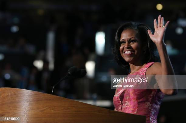 First lady Michelle Obama waves on stage during day one of the Democratic National Convention at Time Warner Cable Arena on September 4 2012 in...