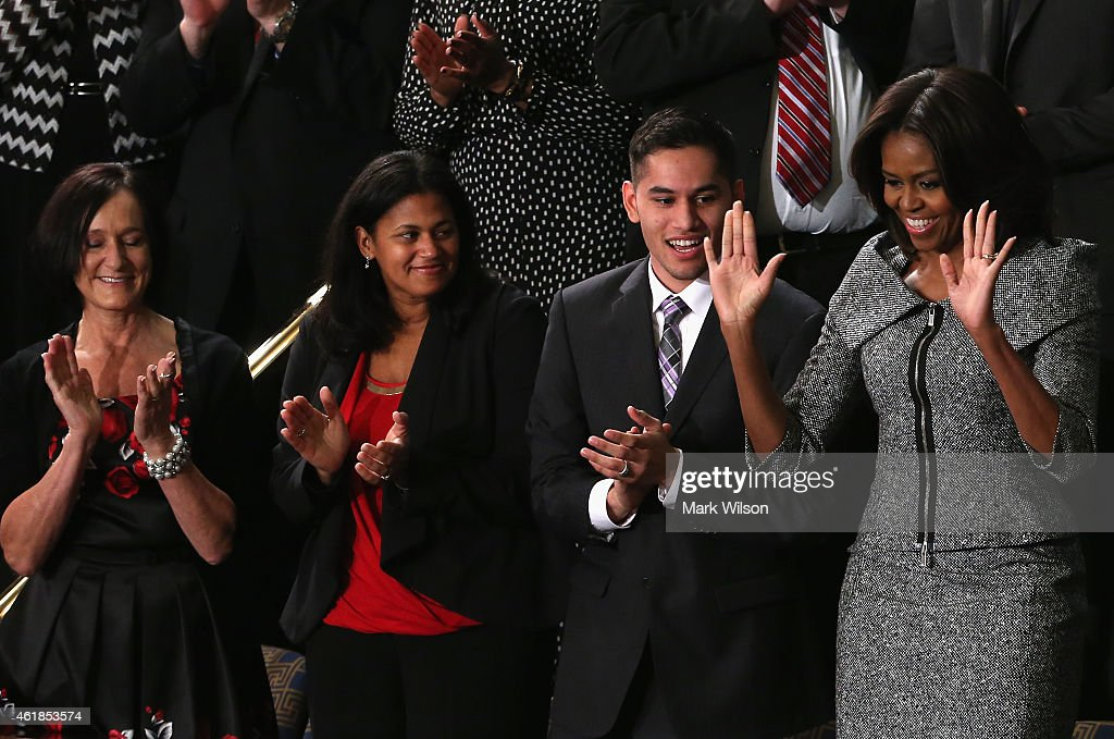 First lady Michelle Obama waves standing with Carolyn Reed of Denver Colorado Astrid Muhammad of North Carolina and Anthony Mendez of Bronx New York...