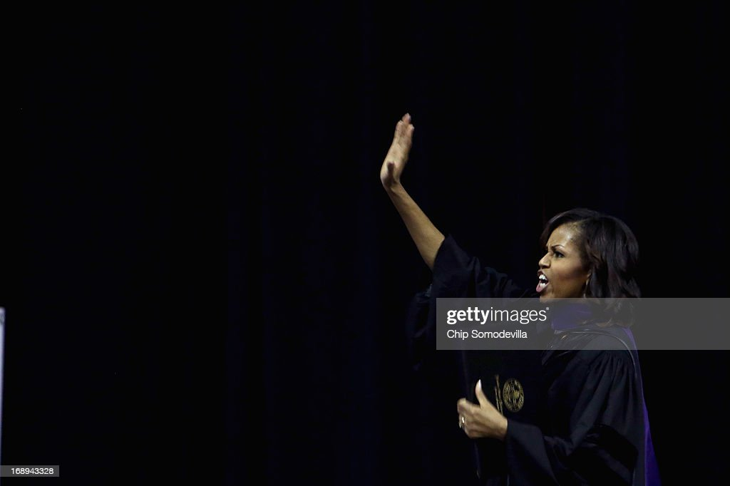 First lady Michelle Obama waves to admirerers after delivering the commencement speech during the Bowie State University graduation ceremony at the Comcast Center on the campus of the University of Maryland May 17, 2013 in College Park, Maryland. Obama received and Honorary Doctor of Laws degree before addressing the 600 graduates of Maryland's oldest historically black university and one of the ten oldest in the country.