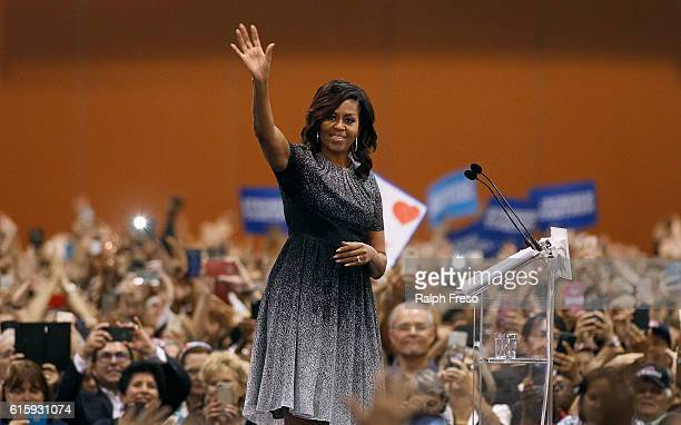 First Lady Michelle Obama waves to the crowd as she speaks at an Arizona Democratic Party Early Vote rally in support of Democratic presidential...
