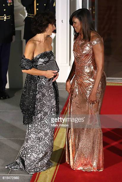 First lady Michelle Obama welcomes Mrs Agnese Landini wife of Italian Prime Minister Matteo Renzi upon their arrival for a state dinner at the White...