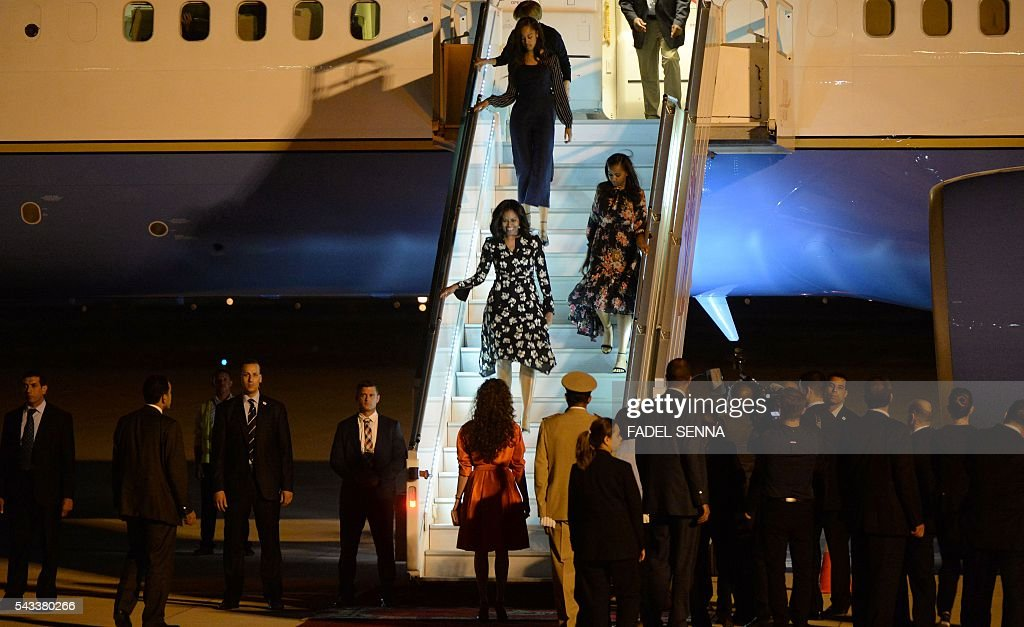 US first lady Michelle Obama with daughters Sasha and Malia step off the plane as they are welcomed by the Moroccan Princess Lalla Salma at the Marrakech International Airport, on June 28, 2016 / AFP / FADEL