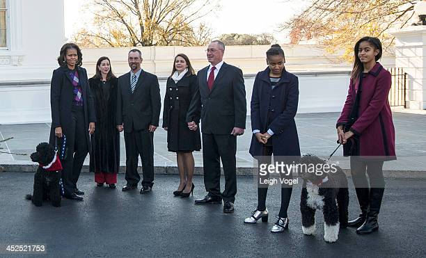 First lady Michelle Obama with dog Sunny Kyra Yurko Christopher Botek Leslie Wyckoff John Wyckoff Sasha Obama Malia Obama with dog Bo welcome the...