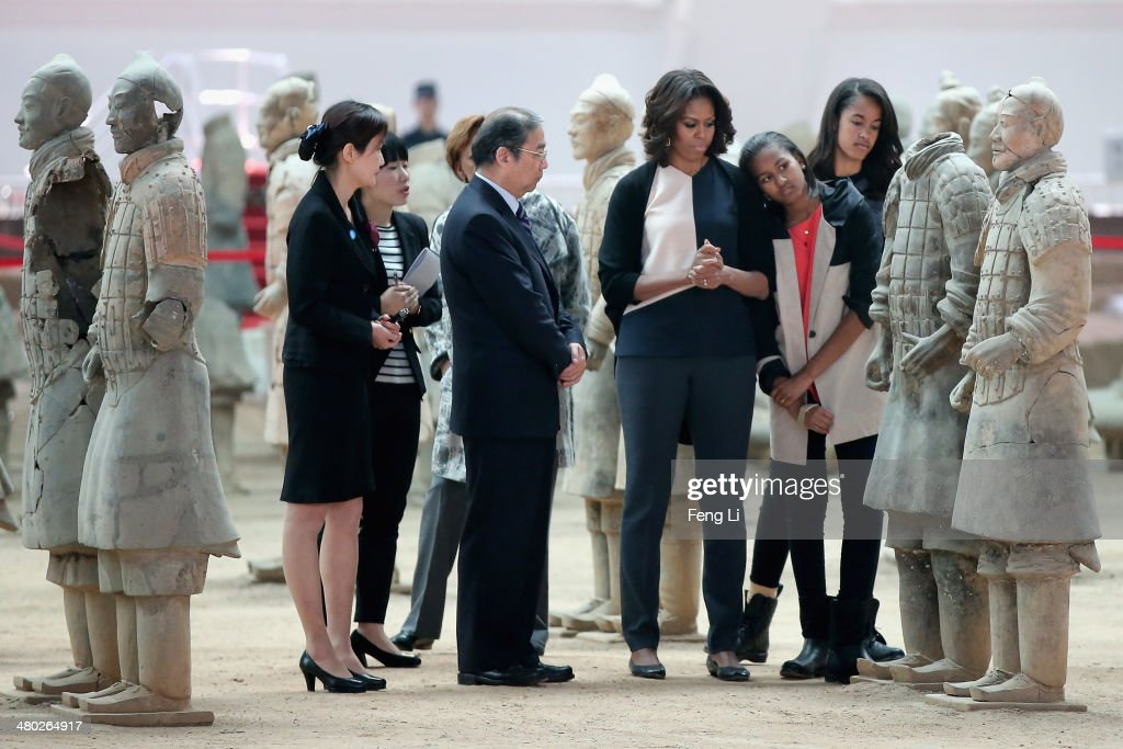 XI'AN, CHINA - MARCH 24: First Lady <a gi-track='captionPersonalityLinkClicked' href=/galleries/search?phrase=Michelle+Obama&family=editorial&specificpeople=2528864 ng-click='$event.stopPropagation()'>Michelle Obama</a> (3rd Right) with her daughters <a gi-track='captionPersonalityLinkClicked' href=/galleries/search?phrase=Malia+Obama&family=editorial&specificpeople=2631620 ng-click='$event.stopPropagation()'>Malia Obama</a> (Right) and <a gi-track='captionPersonalityLinkClicked' href=/galleries/search?phrase=Sasha+Obama&family=editorial&specificpeople=2631619 ng-click='$event.stopPropagation()'>Sasha Obama</a> (2nd Right) visit Museum of Terracotta Warriors during a visit to the historic excavation site on March 24, 2014 in Xi'an, China. <a gi-track='captionPersonalityLinkClicked' href=/galleries/search?phrase=Michelle+Obama&family=editorial&specificpeople=2528864 ng-click='$event.stopPropagation()'>Michelle Obama</a>'s one-week-long visit in China will be focused on educational and cultural exchanges.