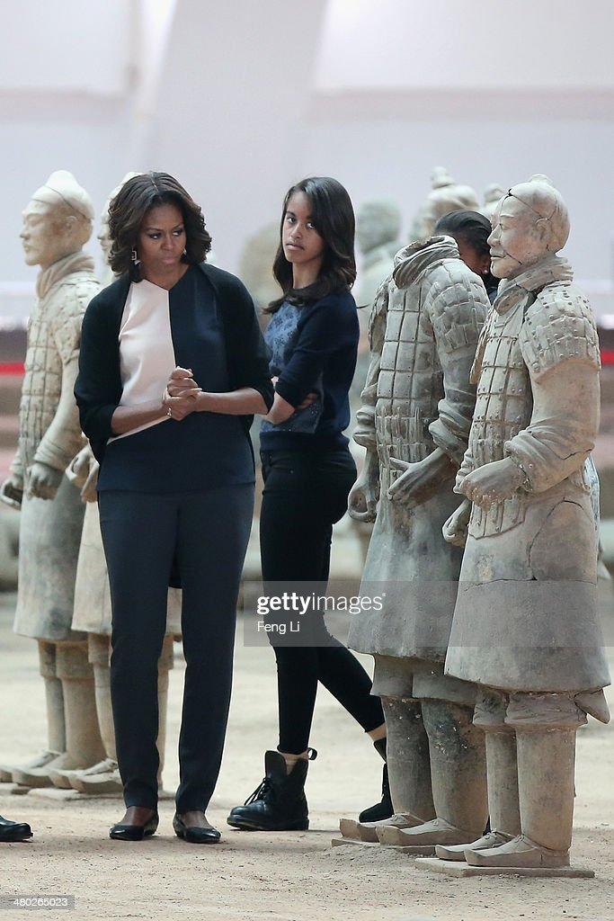 XI'AN, CHINA - MARCH 24: First Lady Michelle Obama (Left) with her daughters Malia Obama (Right) and Sasha Obama visit Museum of Terracotta Warriors during a visit to the historic excavation site on March 24, 2014 in Xi'an, China. Michelle Obama's one-week-long visit in China will be focused on educational and cultural exchanges.