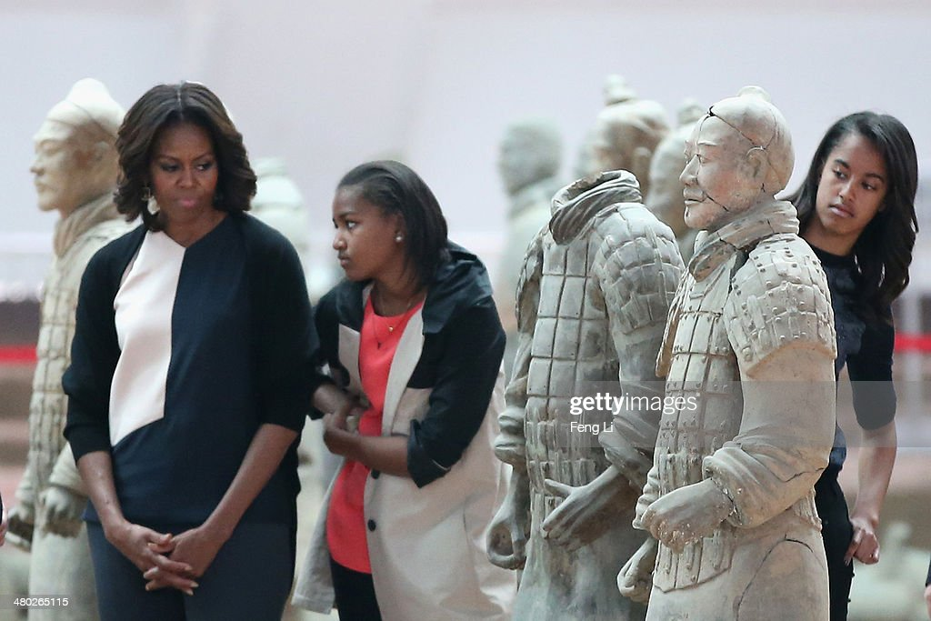 XI'AN, CHINA - MARCH 24: First Lady Michelle Obama (Left) with her daughters Malia Obama (Right) and Sasha Obama (Center), mother Marian Robinson visit Museum of Terracotta Warriors during a visit to the historic excavation site on March 24, 2014 in Xi'an, China. Michelle Obama's one-week-long visit in China will be focused on educational and cultural exchanges.