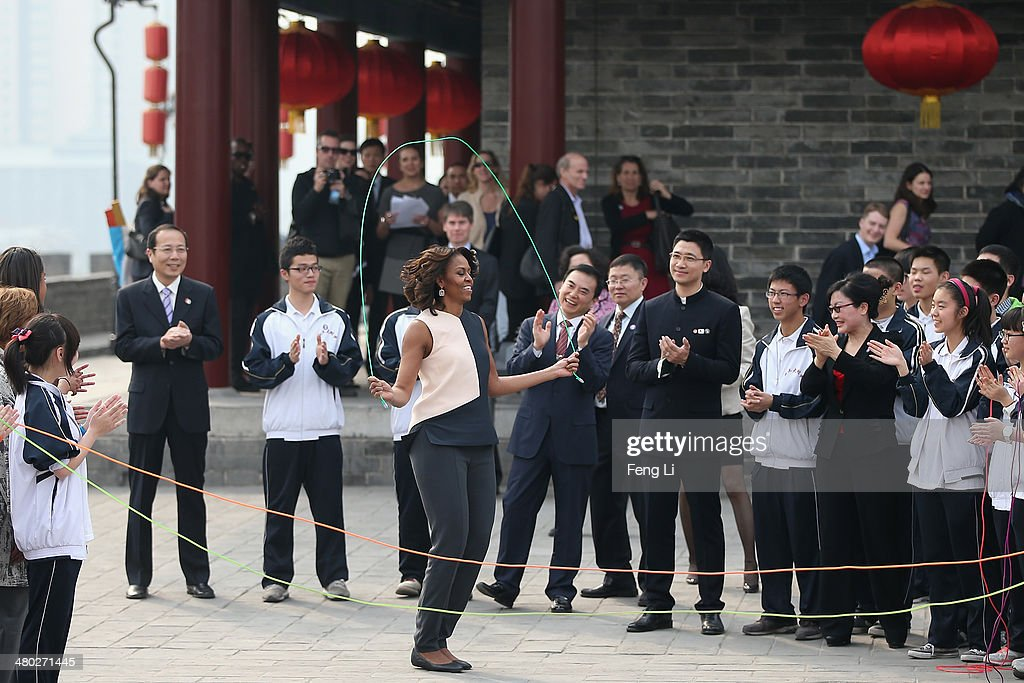 XI'AN, CHINA - MARCH 24: First Lady <a gi-track='captionPersonalityLinkClicked' href=/galleries/search?phrase=Michelle+Obama&family=editorial&specificpeople=2528864 ng-click='$event.stopPropagation()'>Michelle Obama</a> (Center) with her daughters Malia Obama and Sasha Obama, mother Marian Robinson visit the Xi'an City Wall on March 24, 2014 in Xi'an, China. <a gi-track='captionPersonalityLinkClicked' href=/galleries/search?phrase=Michelle+Obama&family=editorial&specificpeople=2528864 ng-click='$event.stopPropagation()'>Michelle Obama</a>'s one-week-long visit in China will be focused on educational and cultural exchanges. <a gi-track='captionPersonalityLinkClicked' href=/galleries/search?phrase=Michelle+Obama&family=editorial&specificpeople=2528864 ng-click='$event.stopPropagation()'>Michelle Obama</a>'s one-week-long visit in China will be focused on educational and cultural exchanges.