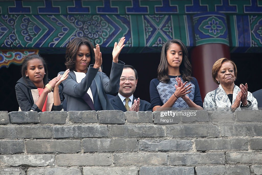 XI'AN, CHINA - MARCH 24: First Lady <a gi-track='captionPersonalityLinkClicked' href=/galleries/search?phrase=Michelle+Obama&family=editorial&specificpeople=2528864 ng-click='$event.stopPropagation()'>Michelle Obama</a> (2nd Left) with her daughters <a gi-track='captionPersonalityLinkClicked' href=/galleries/search?phrase=Malia+Obama&family=editorial&specificpeople=2631620 ng-click='$event.stopPropagation()'>Malia Obama</a> (2nd Right) and <a gi-track='captionPersonalityLinkClicked' href=/galleries/search?phrase=Sasha+Obama&family=editorial&specificpeople=2631619 ng-click='$event.stopPropagation()'>Sasha Obama</a> (Left), mother <a gi-track='captionPersonalityLinkClicked' href=/galleries/search?phrase=Marian+Robinson&family=editorial&specificpeople=5505642 ng-click='$event.stopPropagation()'>Marian Robinson</a> (Right) visit the Xi'an City Wall on March 24, 2014 in Xi'an, China. <a gi-track='captionPersonalityLinkClicked' href=/galleries/search?phrase=Michelle+Obama&family=editorial&specificpeople=2528864 ng-click='$event.stopPropagation()'>Michelle Obama</a>'s one-week-long visit in China will be focused on educational and cultural exchanges. <a gi-track='captionPersonalityLinkClicked' href=/galleries/search?phrase=Michelle+Obama&family=editorial&specificpeople=2528864 ng-click='$event.stopPropagation()'>Michelle Obama</a>'s one-week-long visit in China will be focused on educational and cultural exchanges.