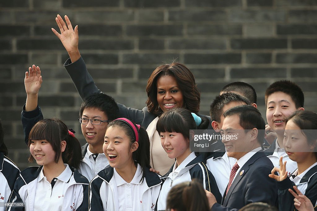 First Lady Michelle Obama (Center) with her daughters Malia Obama and Sasha Obama, mother Marian Robinson visit the Xi'an City Wall on March 24, 2014 in Xi'an, China. Michelle Obama's one-week-long visit in China will be focused on educational and cultural exchanges. Michelle Obama's one-week-long visit in China will be focused on educational and cultural exchanges.