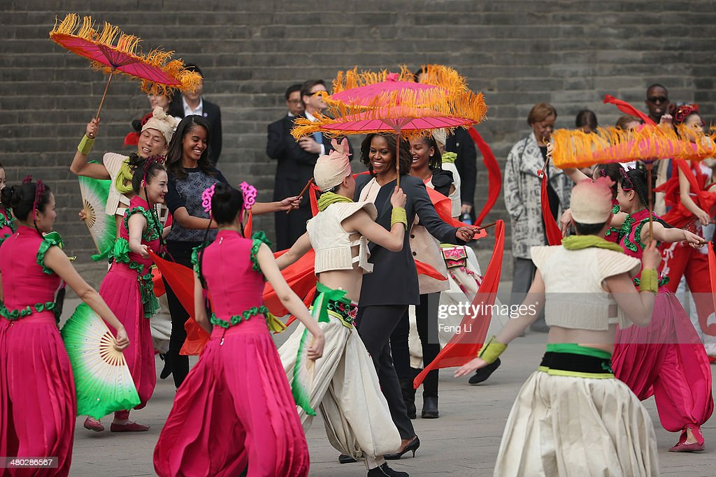 XI'AN, CHINA - MARCH 24: First Lady <a gi-track='captionPersonalityLinkClicked' href=/galleries/search?phrase=Michelle+Obama&family=editorial&specificpeople=2528864 ng-click='$event.stopPropagation()'>Michelle Obama</a> with her daughters <a gi-track='captionPersonalityLinkClicked' href=/galleries/search?phrase=Malia+Obama&family=editorial&specificpeople=2631620 ng-click='$event.stopPropagation()'>Malia Obama</a> and <a gi-track='captionPersonalityLinkClicked' href=/galleries/search?phrase=Sasha+Obama&family=editorial&specificpeople=2631619 ng-click='$event.stopPropagation()'>Sasha Obama</a>, mother Marian Robinson visit the Xi'an City Wall on March 24, 2014 in Xi'an, China. <a gi-track='captionPersonalityLinkClicked' href=/galleries/search?phrase=Michelle+Obama&family=editorial&specificpeople=2528864 ng-click='$event.stopPropagation()'>Michelle Obama</a>'s one-week-long visit in China will be focused on educational and cultural exchanges. <a gi-track='captionPersonalityLinkClicked' href=/galleries/search?phrase=Michelle+Obama&family=editorial&specificpeople=2528864 ng-click='$event.stopPropagation()'>Michelle Obama</a>'s one-week-long visit in China will be focused on educational and cultural exchanges.