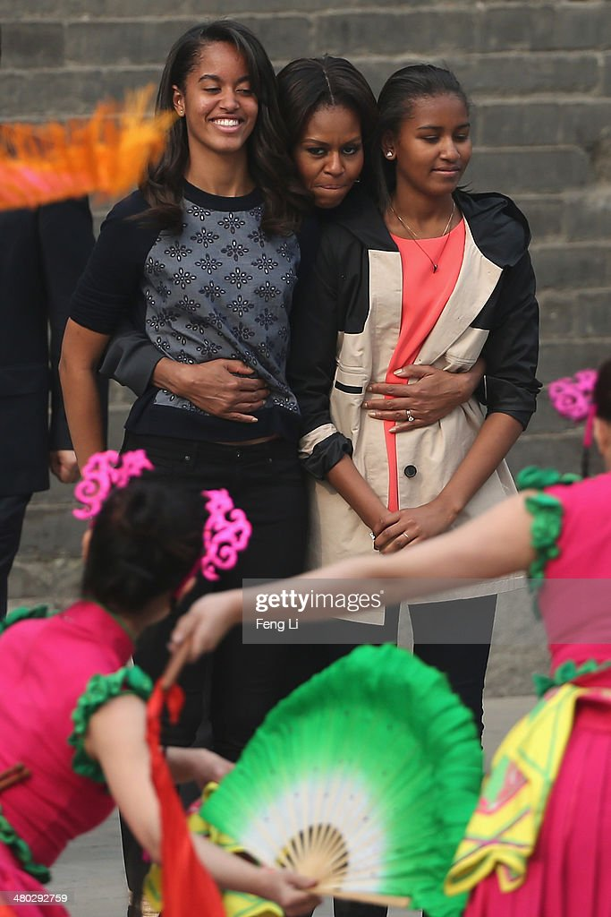 First Lady Michelle Obama (Center) with her daughters Malia Obama (Left) and Sasha Obama (Right), mother Marian Robinson visit the Xi'an City Wall on March 24, 2014 in Xi'an, China. Michelle Obama's one-week-long visit in China will be focused on educational and cultural exchanges. Michelle Obama's one-week-long visit in China will be focused on educational and cultural exchanges.