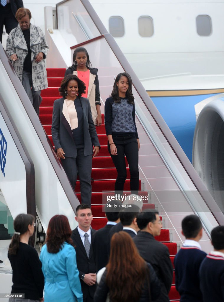 First Lady <a gi-track='captionPersonalityLinkClicked' href=/galleries/search?phrase=Michelle+Obama&family=editorial&specificpeople=2528864 ng-click='$event.stopPropagation()'>Michelle Obama</a> with her daughters Malia Obama and Sasha Obama arrives at Chengdu Shuangliu International Airport on March 24, 2014 in Chengdu, Sichuan Province of China. <a gi-track='captionPersonalityLinkClicked' href=/galleries/search?phrase=Michelle+Obama&family=editorial&specificpeople=2528864 ng-click='$event.stopPropagation()'>Michelle Obama</a>'s one-week-long visit in China will be focused on educational and cultural exchanges. <a gi-track='captionPersonalityLinkClicked' href=/galleries/search?phrase=Michelle+Obama&family=editorial&specificpeople=2528864 ng-click='$event.stopPropagation()'>Michelle Obama</a>'s one-week-long visit in China will be focused on educational and cultural exchanges.