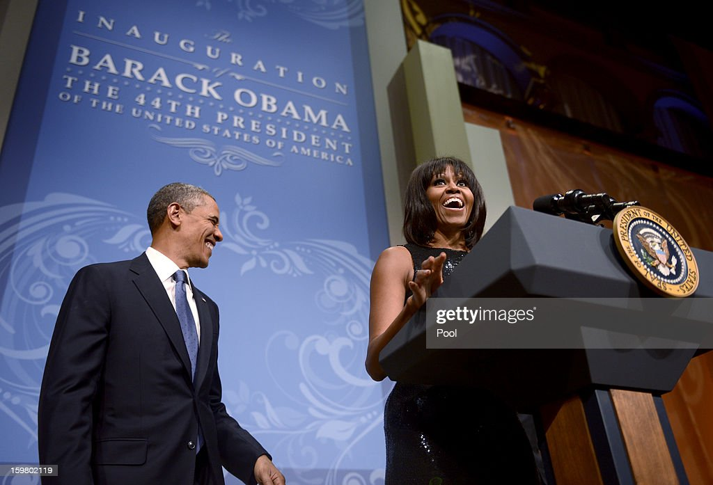 First lady Michelle Obama, with U.S. President Barack Obama, steps up to the podium to deliver remarks at the Inaugural Reception at the National Building Museum on January 20, 2013 in Washington, D.C. Obama defeated Republican candidate Mitt Romney on Election Day 06 November 2012 to be re-elected for a second term.