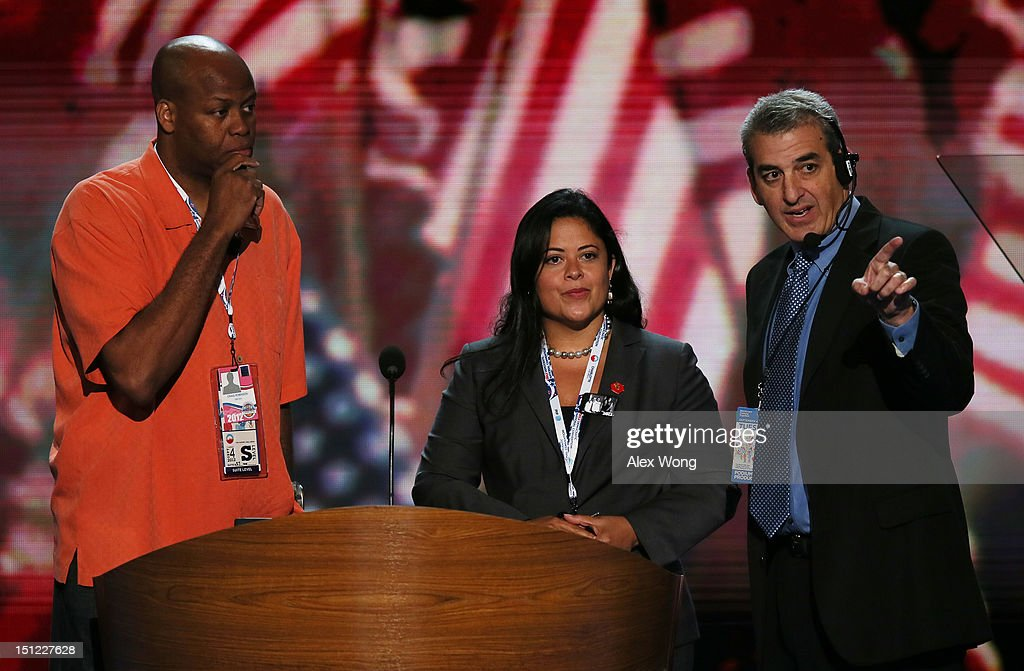 First lady Michelle Obama's brother Craig Robinson (L) and U.S. President Barack Obama's sister Dr. Maya Kassandra Soetoro-Ng stand at the podium with stage manager David Cove on stage for a walkthrough during day one of the Democratic National Convention at Time Warner Cable Arena on September 4, 2012 in Charlotte, North Carolina. The DNC that will run through September 7, will nominate U.S. President Barack Obama as the Democratic presidential candidate.