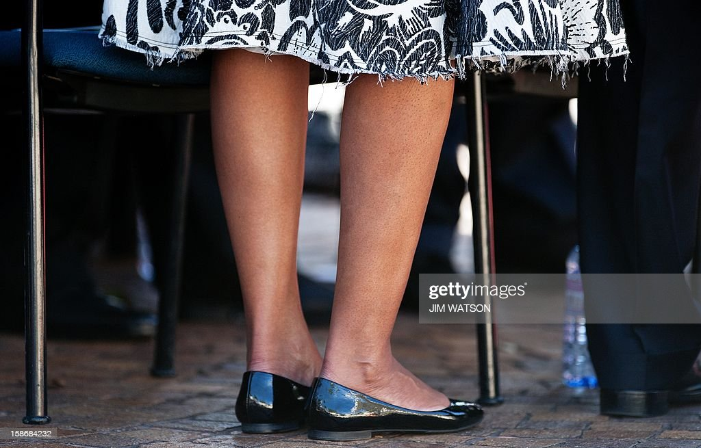 First Lady Michelle Obama's dress hem as she attends the memorial service for the late Senator Daniel Inouye at the National Memorial Cremetary of the Pacific in Honolulu, Hawaii, December 23, 2012. AFP Photo/Jim WATSON