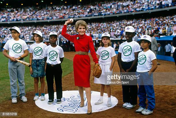 First Lady Nancy Reagan throws the ceremonial first pitch of the 1988 World Series featuring the Oakland Athletics and the Los Angeles Dodgers at...