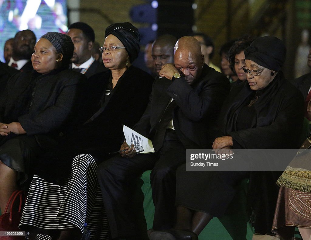 First lady Nompumelelo Ntuli, Graca Machel, President Jacob Zuma and Winnie Madikizela-Mandelaat the official send-off for Nelson Mandela at the Waterkloof Air Base on December 14, 2013 in Pretoria, South Africa. World icon, Nelson Mandela passed away quietly on the evening of December 5, 2013 at his home in Houghton with family. Tata will be laid to rest at his homestead tomorrow.