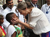 First Lady of Colombia María Clemencia Rodríguez Múnera meets children outside the Museo del Oro Zenu on October 31 2014 in Cartagena Colombia The...