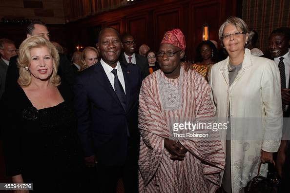 First Lady of Ivory Coast Dominique FollorouxOuattara Ivory Coast President Alassane Ouattara Oluṣẹgun Ọbasanjọ former President of Nigeria and guest...
