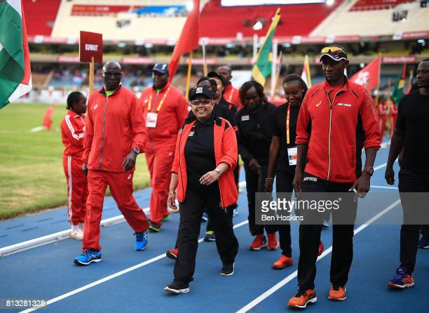 First Lady of Kenya Margaret Kenyatta waves to the crowds during the opening ceremony on day one of the IAAF U18 World Championships at the Kasarani...