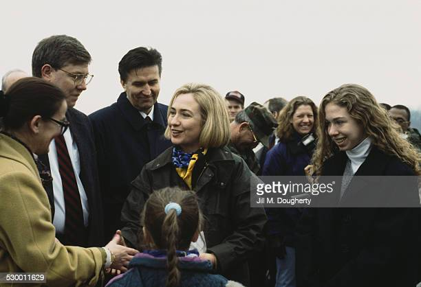 First Lady of the United States Hillary Clinton and her daughter Chelsea meet the crowd as they visit US troops at Tuzla Air Base Bosnia and...