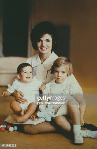 First Lady of the United States Jackie Kennedy posed with her children John and Caroline circa 1961 Photo by Rolls Press/Popperfoto/Getty Images