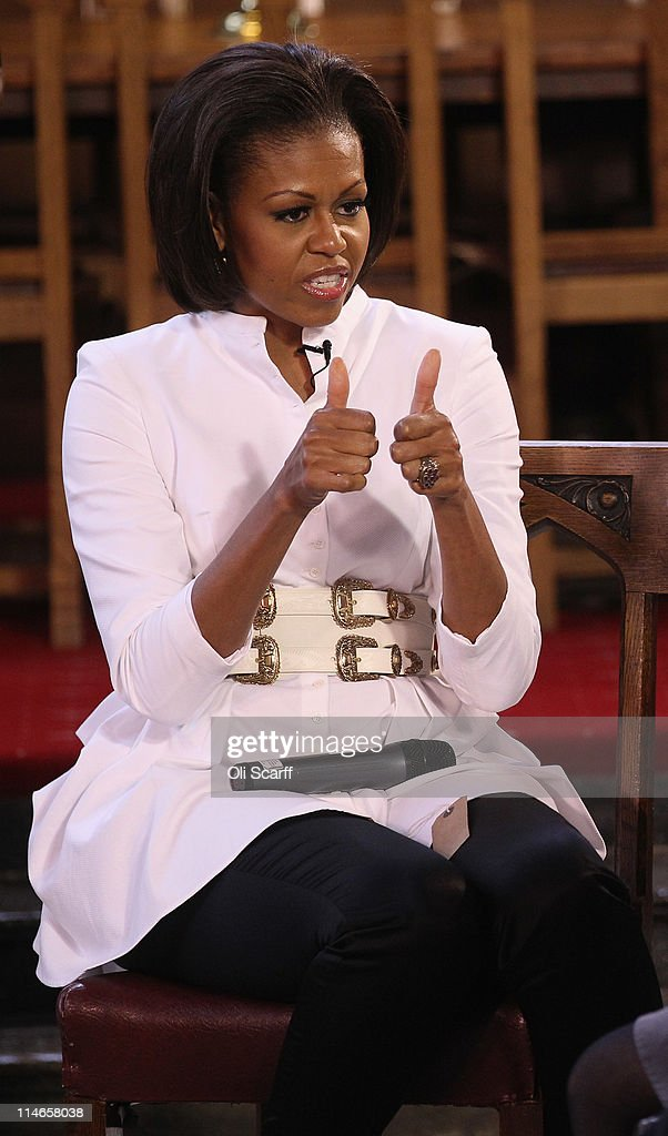 First Lady of the United States, <a gi-track='captionPersonalityLinkClicked' href=/galleries/search?phrase=Michelle+Obama&family=editorial&specificpeople=2528864 ng-click='$event.stopPropagation()'>Michelle Obama</a>, gestures to students after delivering a speech and answers their questions in Christ Church dining hall in the University of Oxford on May 25, 2011 in Oxford, England. Mrs Obama joined female students from the Elizabeth Garrett Anderson School in North London for an open day at the University of Oxford. The 44th President of the United States, Barack Obama, and his wife Michelle are in the UK for a two day State Visit at the invitation of HM Queen Elizabeth II. Last night they attended a state banquet at Buckingham Palace and today's events include talks at Downing Street and the President will address both houses of parliament at Westminster Hall.