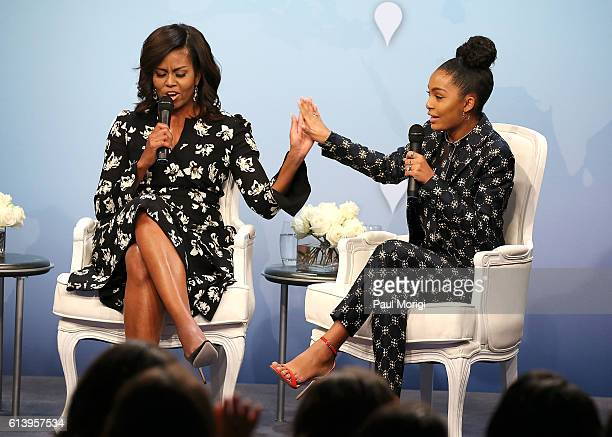 First Lady of the United States Michelle Obama greets actress and activist Yara Shahidi with a 'high five' during a panel discussion at Glamour Hosts...
