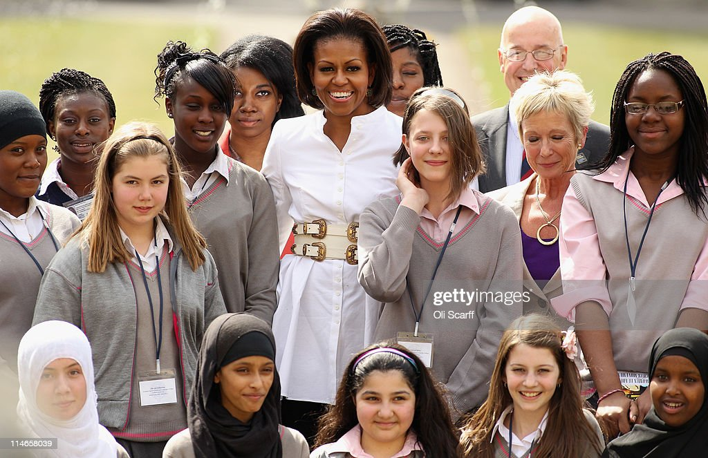 First Lady of the United States, Michelle Obama, poses with students and dignitaries after delivering a speech and answers student's questions in Christ Church dining hall in the University of Oxford on May 25, 2011 in Oxford, England. Mrs Obama joined female students from the Elizabeth Garrett Anderson School in North London for an open day at the University of Oxford. The 44th President of the United States, Barack Obama, and his wife Michelle are in the UK for a two day State Visit at the invitation of HM Queen Elizabeth II. Last night they attended a state banquet at Buckingham Palace and today's events include talks at Downing Street and the President will address both houses of parliament at Westminster Hall.