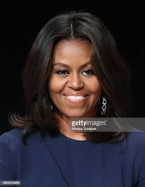 First Lady of the United States Michelle Obama speaks at the 'Let Girls Learn' Global Conversation at The Apollo Theater on September 29 2015 in New...