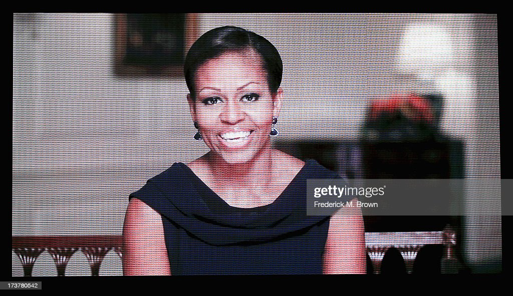 First Lady of the United States Michelle Obama speaks in a video broadcast at The 2013 ESPY Awards at Nokia Theatre L.A. Live on July 17, 2013 in Los Angeles, California.