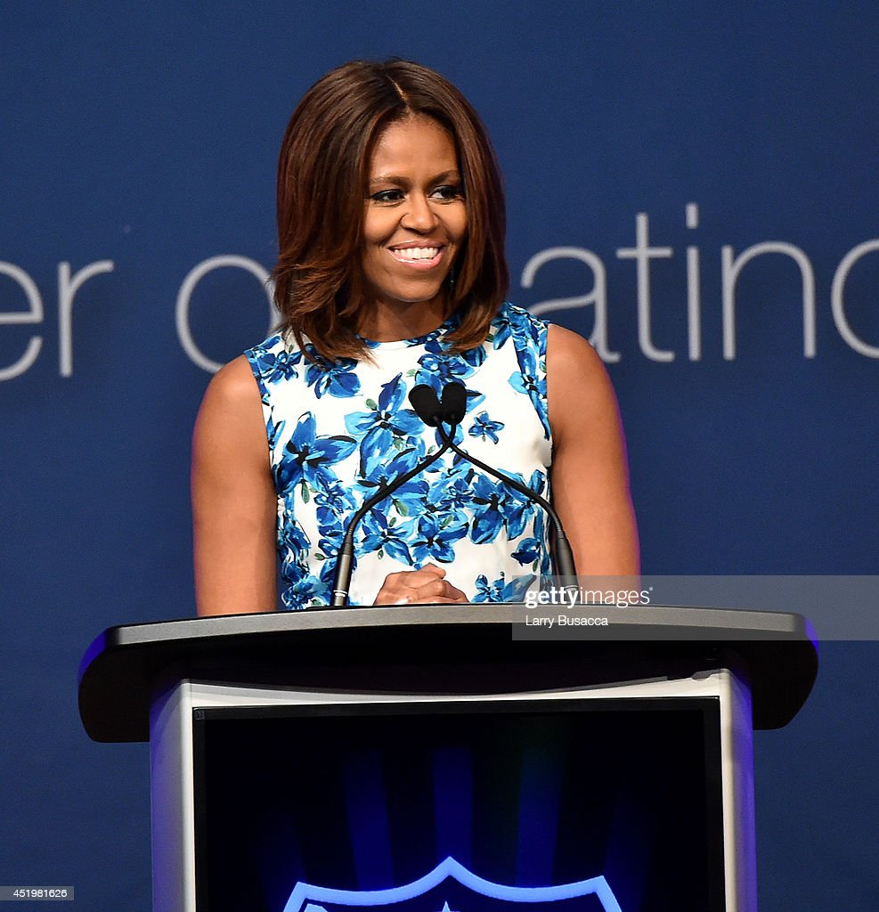 First Lady of the United States <a gi-track='captionPersonalityLinkClicked' href=/galleries/search?phrase=Michelle+Obama&family=editorial&specificpeople=2528864 ng-click='$event.stopPropagation()'>Michelle Obama</a> speaks onstage at the LULAC/NUVOtv Unity Luncheon With Jennifer Lopez at New York Hilton Midtown on July 10, 2014 in New York City.