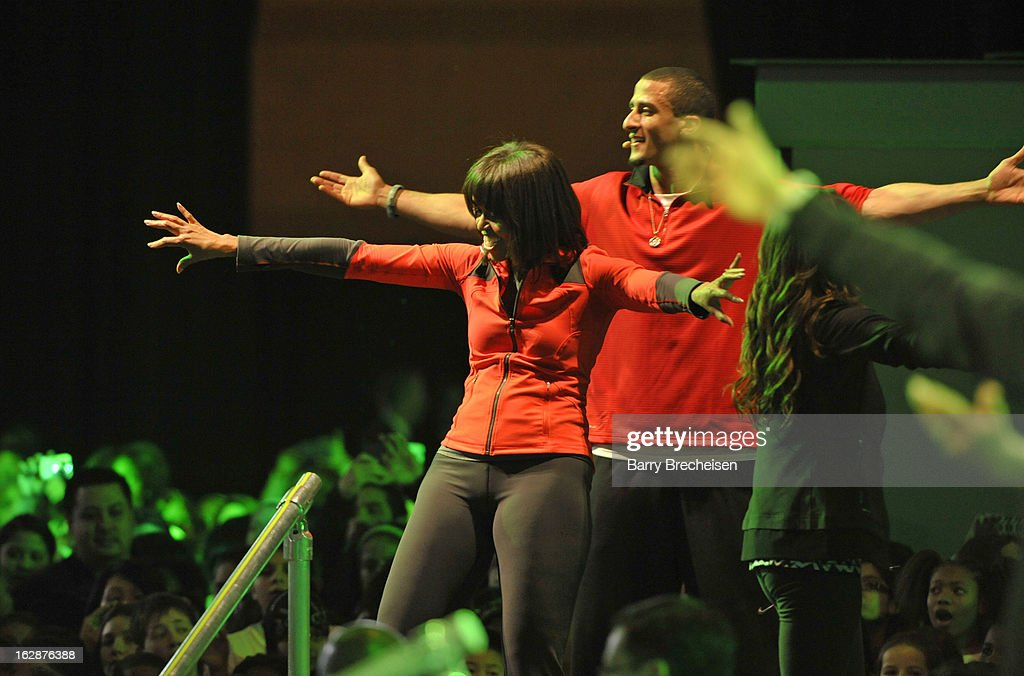 First Lady of the United States of America Michelle Obama and Nike athlete Colin Kaepernick jumped, kicked, spun and danced with nearly 6,000 local Chicago school kids during the unveiling of a new initiative called 'Let's Move Active Schools' to help schools create a physical activity programs for students at McCormick Place on February 28, 2013 in Chicago, Illinois.