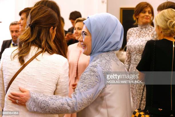 First Lady of Turkey Emine Gulbaran Erdogan is pictured during a visit of the First Ladies to a shop of Belgian fashion label Delvaux on May 25 in...