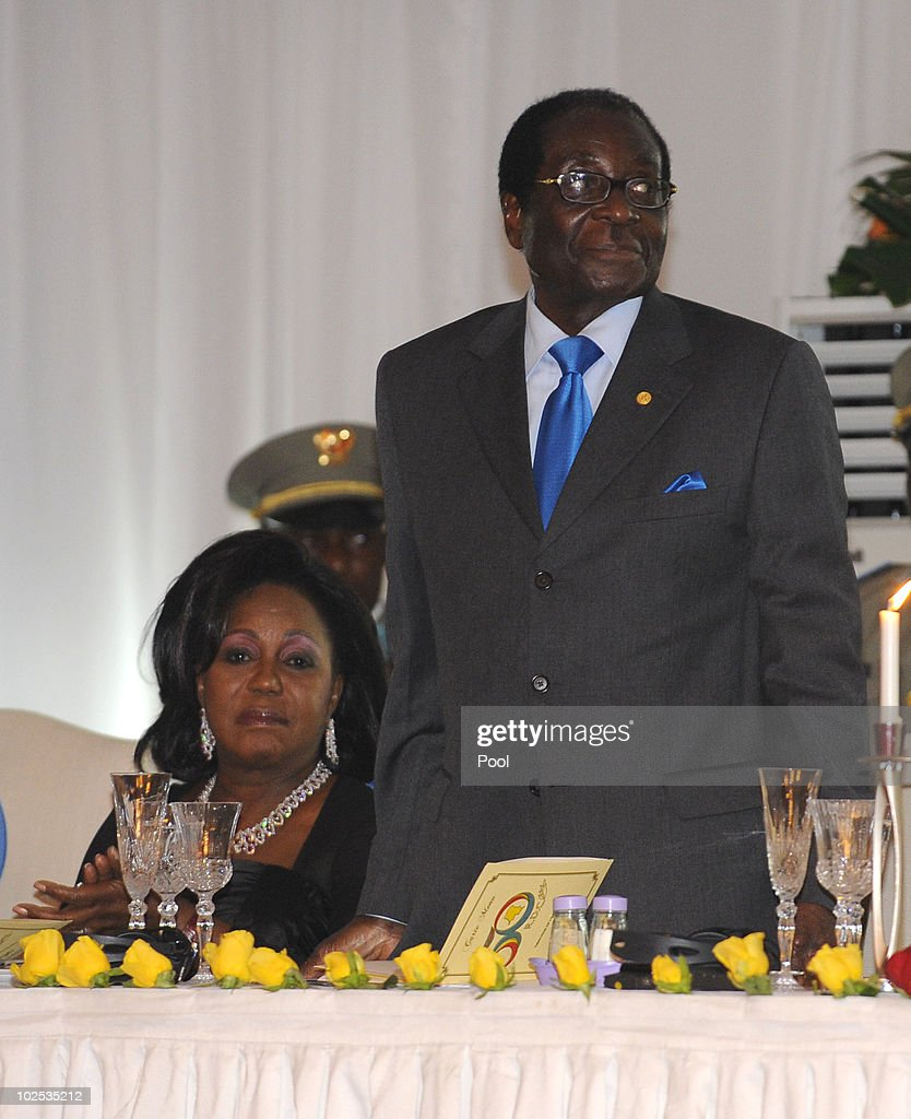 First Lady of Zimbabwe <a gi-track='captionPersonalityLinkClicked' href=/galleries/search?phrase=Grace+Mugabe&family=editorial&specificpeople=2893817 ng-click='$event.stopPropagation()'>Grace Mugabe</a> and President of Zimbabwe <a gi-track='captionPersonalityLinkClicked' href=/galleries/search?phrase=Robert+Mugabe&family=editorial&specificpeople=214676 ng-click='$event.stopPropagation()'>Robert Mugabe</a> attend a gala dinner at Cite de l'Union Africaine on June 29, 2010 in Kinshasa, Democratic Republic of Congo. King Albert II of Belgium and Queen Paola of Belgium are in Congo for a 3-day State visit and to attend the 50th anniversary of the independence of the Democratic Republic of Congo.