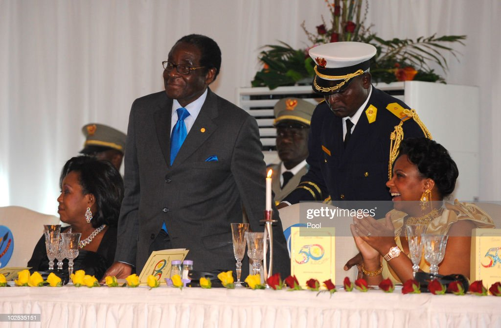 First Lady of Zimbabwe <a gi-track='captionPersonalityLinkClicked' href=/galleries/search?phrase=Grace+Mugabe&family=editorial&specificpeople=2893817 ng-click='$event.stopPropagation()'>Grace Mugabe</a>, President of Zimbabwe <a gi-track='captionPersonalityLinkClicked' href=/galleries/search?phrase=Robert+Mugabe&family=editorial&specificpeople=214676 ng-click='$event.stopPropagation()'>Robert Mugabe</a>, and Congolese First Lady Olive Kabila attend a gala dinner at Cite de l'Union Africaine on June 29, 2010 in Kinshasa, Democratic Republic of Congo. King Albert II of Belgium and Queen Paola of Belgium are in Congo for a 3-day State visit and to attend the 50th anniversary of the independence of the Democratic Republic of Congo.