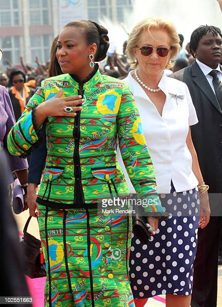 First Lady Olive Kabila and Queen Paola of Belgium attend the 50th anniversary parade marking the independence of the Democratic Republic of Congo on...
